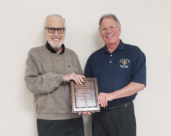 Grand Knight Herb Buhl presents Jerry Koenig with appreciation award for service to Jesus & Company Youth Group Good Shepherd Catholic Church Chilton